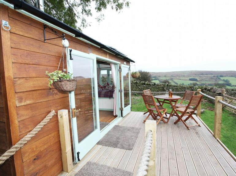 Two beautiful shepherds huts looking out across the Black Mountains