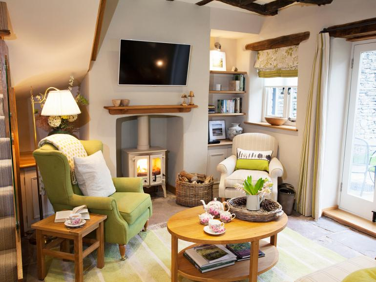 Cosy sitting room with neat woodburner