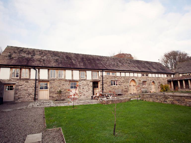 Converted medieval barn, set in its own private walled gardens