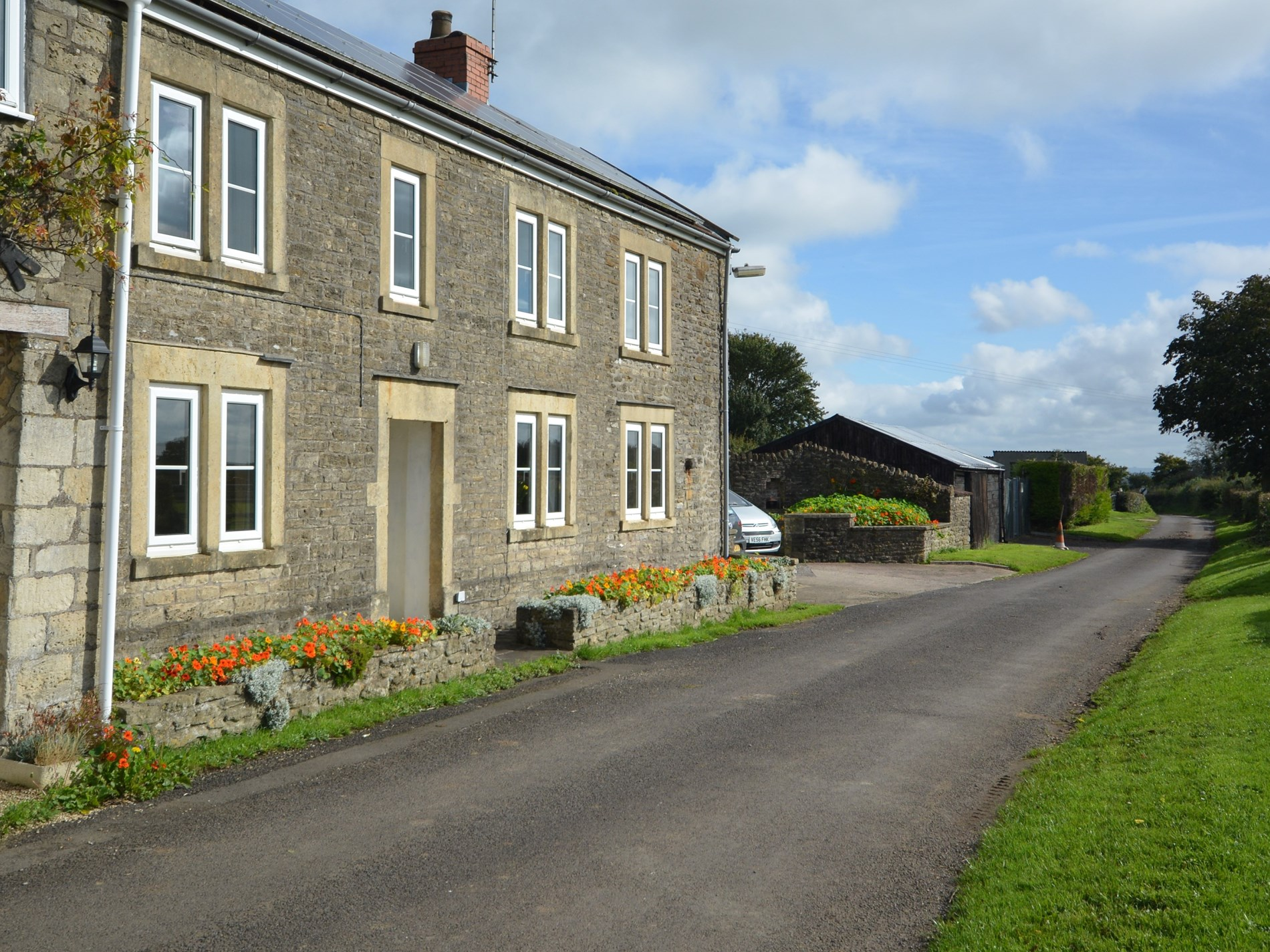 View to the front of the property located on a quiet lane