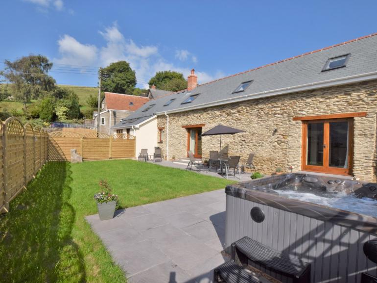 Stay in this beautiful converted barn including private hot tub