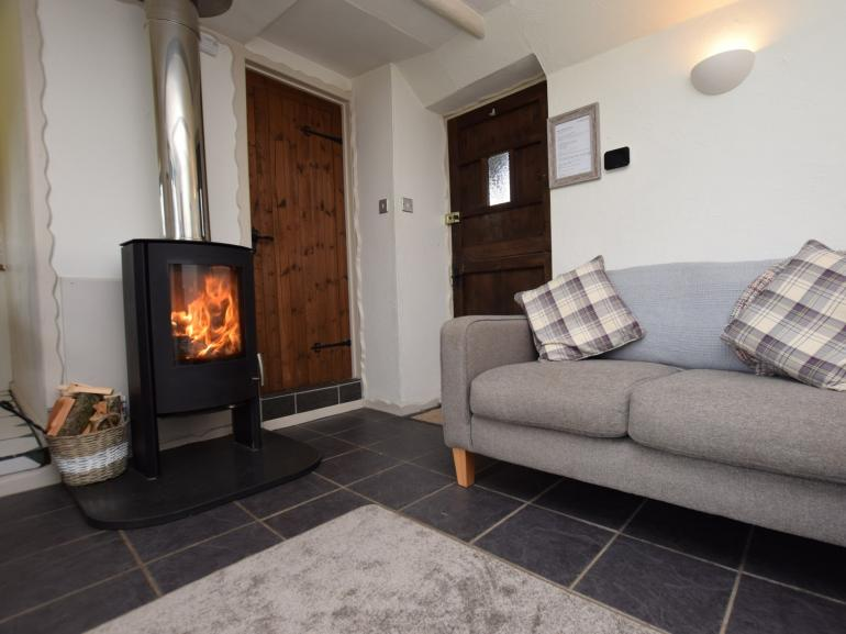 Snuggle up in front of the beautiful woodburner