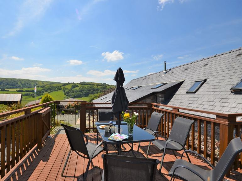 Lovely barn conversion situated in an idyllic hillside location with spectacular terrace views