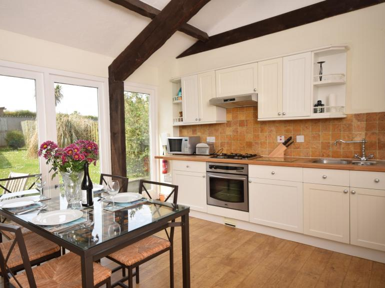 Kitchen with dining area leading out to the garden