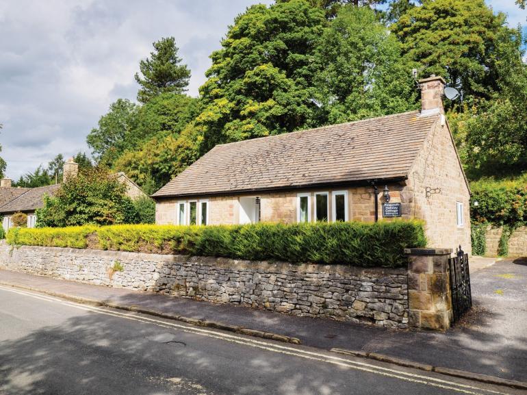 View towards pretty detached cottage