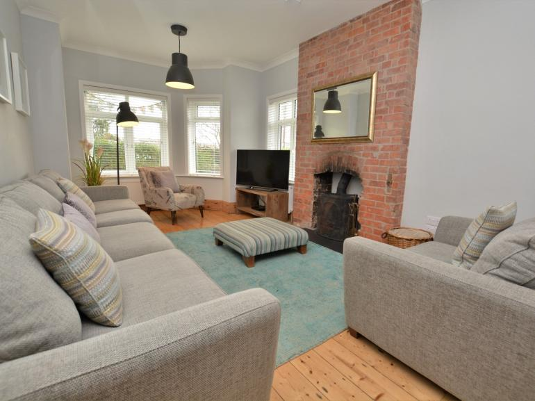 Spacious lounge with cosy woodburner