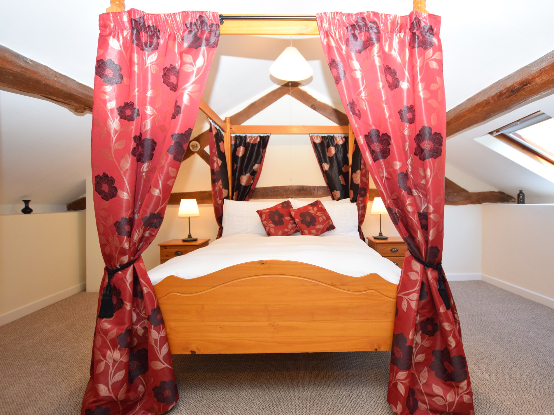 Relax after a busy day exploring in your own four poster bed
