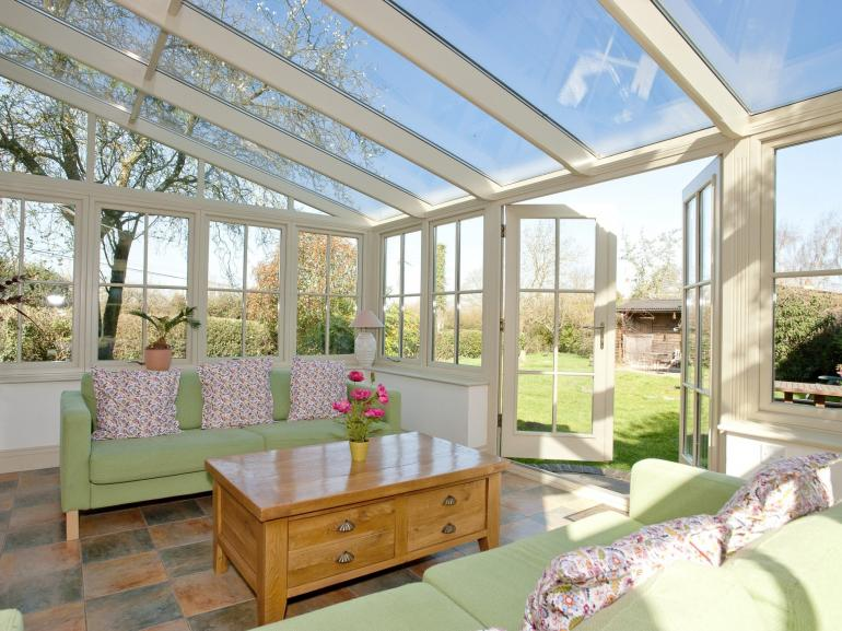 Relax in the conservatory with a good book overlooking the large garden