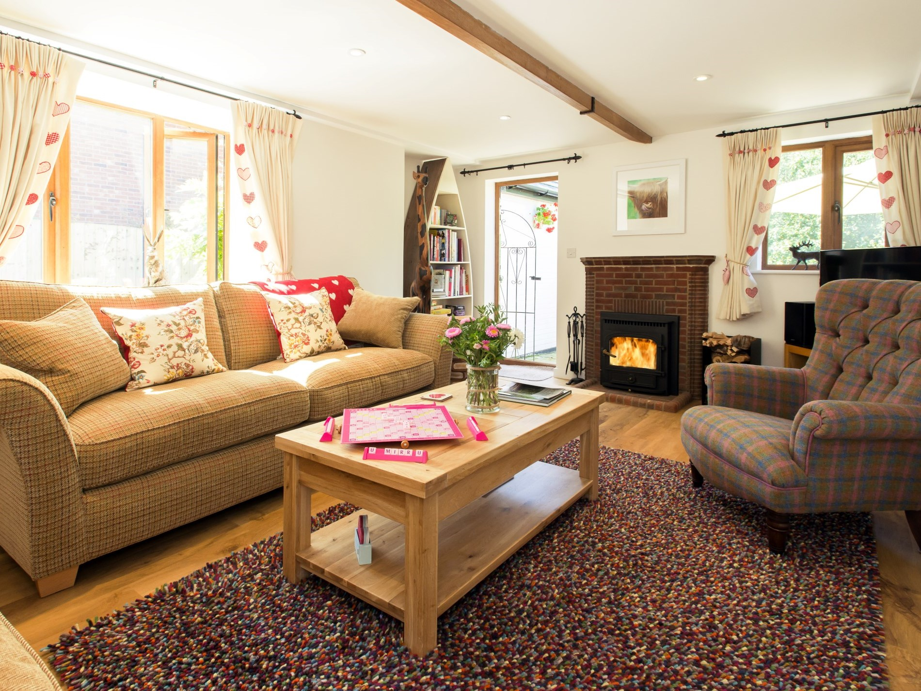 Lounge with welcoming woodburner