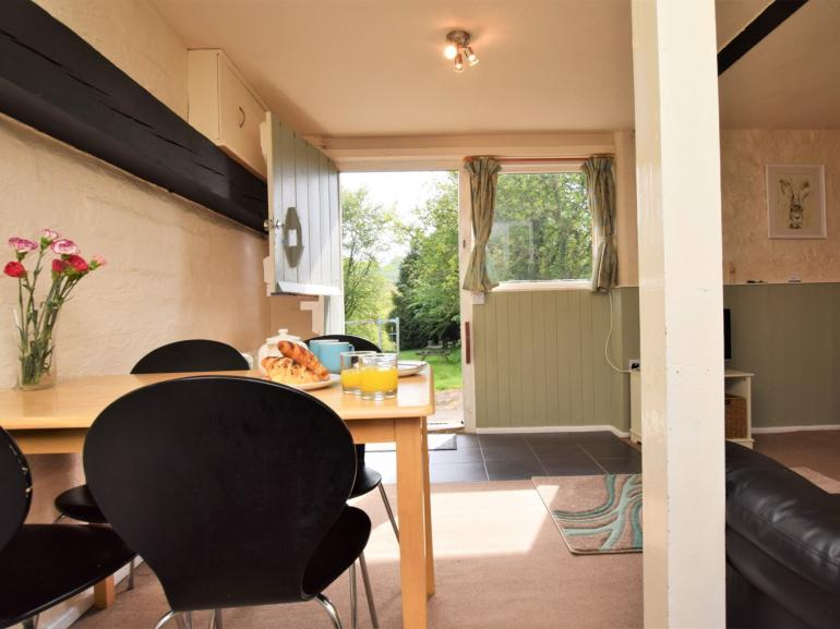 Dining area with views across the garden