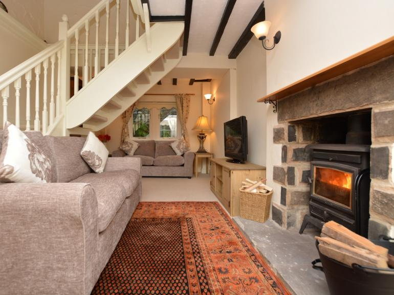 Enjoy sitting by the woodburner in the lounge