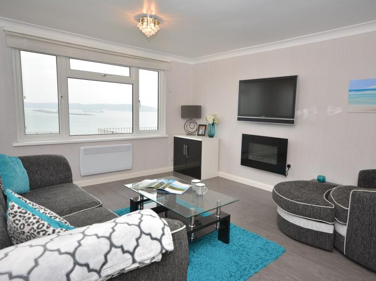 Relax in the lounge area with sea views