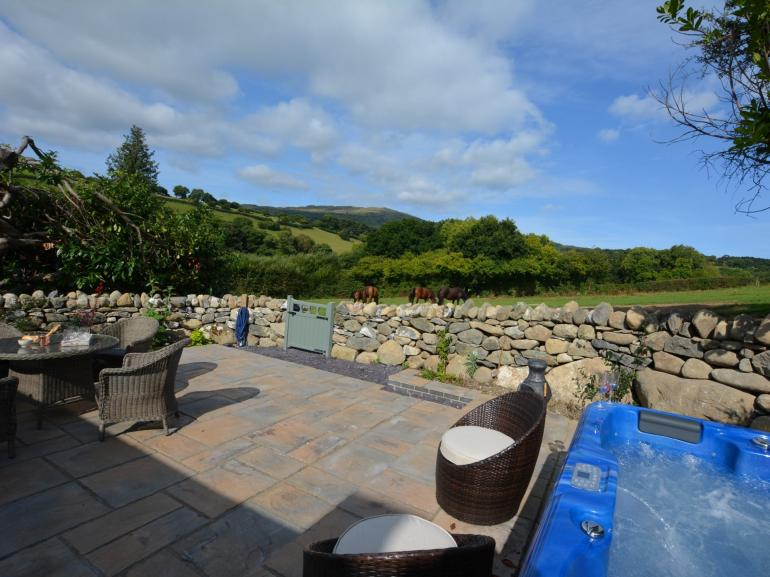 Relax, unwind and enjoy the views from the hot tub