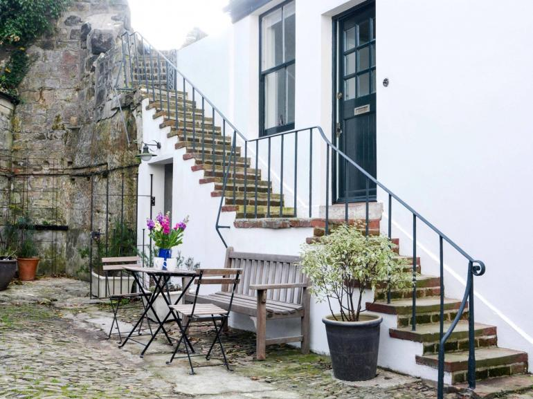 Cobbled coach yard to the front of this elegant property