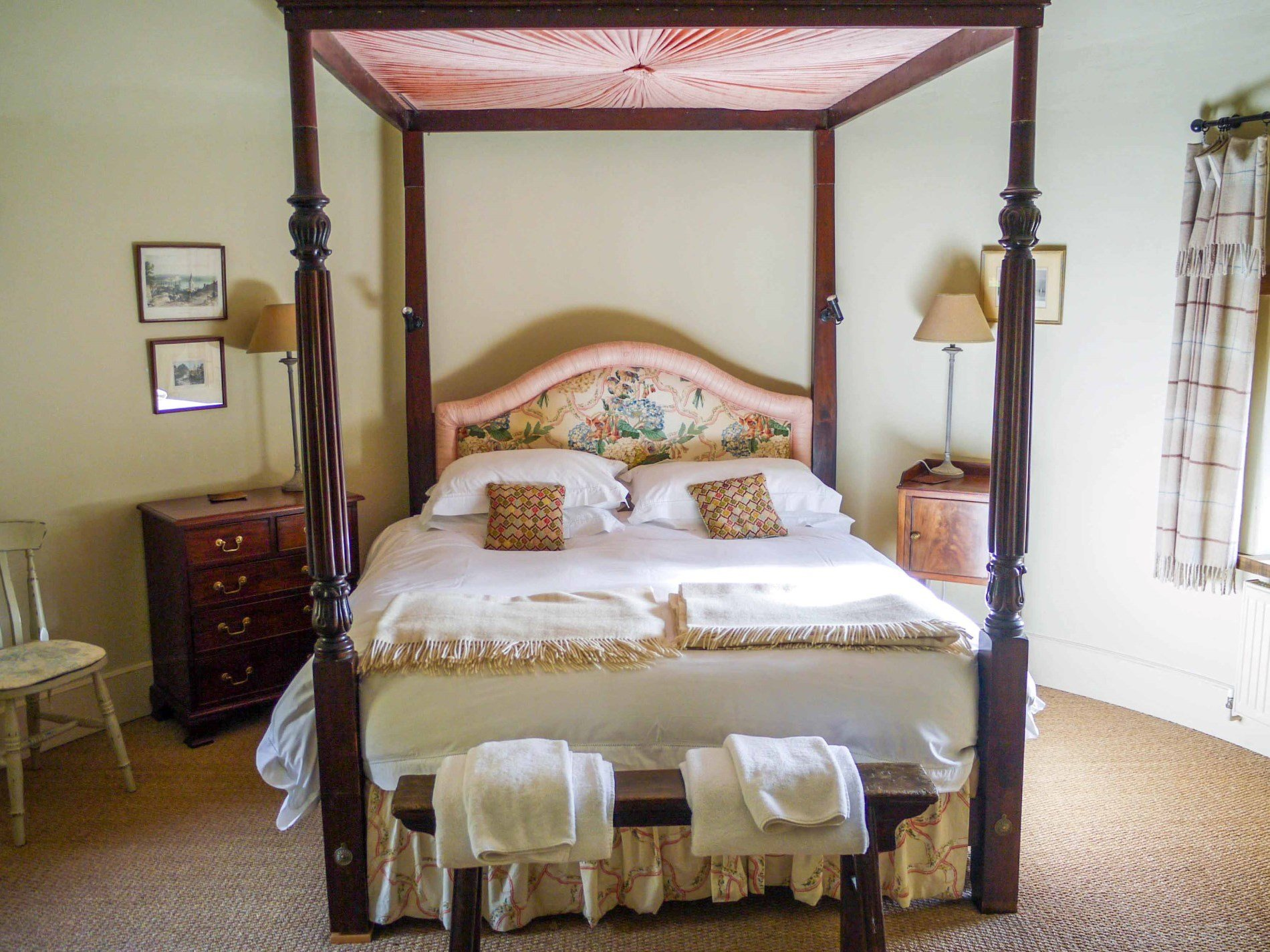 Relax in the elegant four poster bedroom