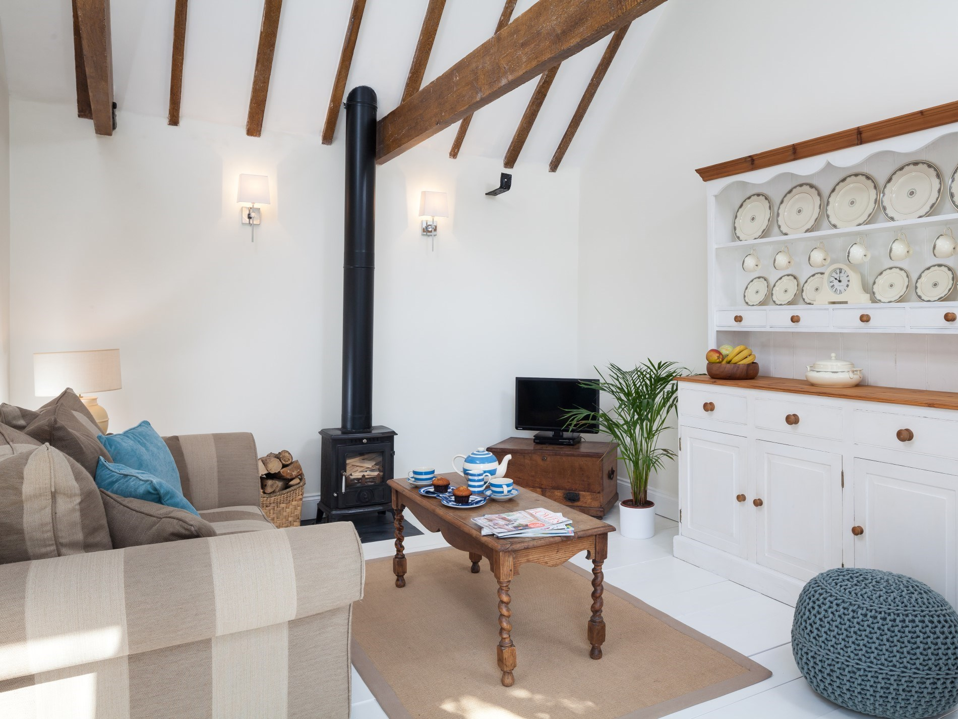 Exposed beams, woodburner and comfy sofa is the perfect combination!