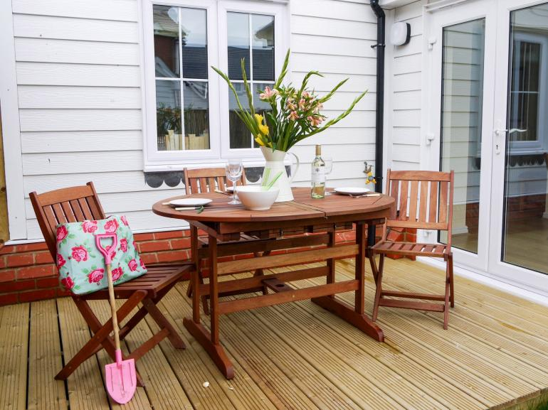 Fully enclosed garden with decked area