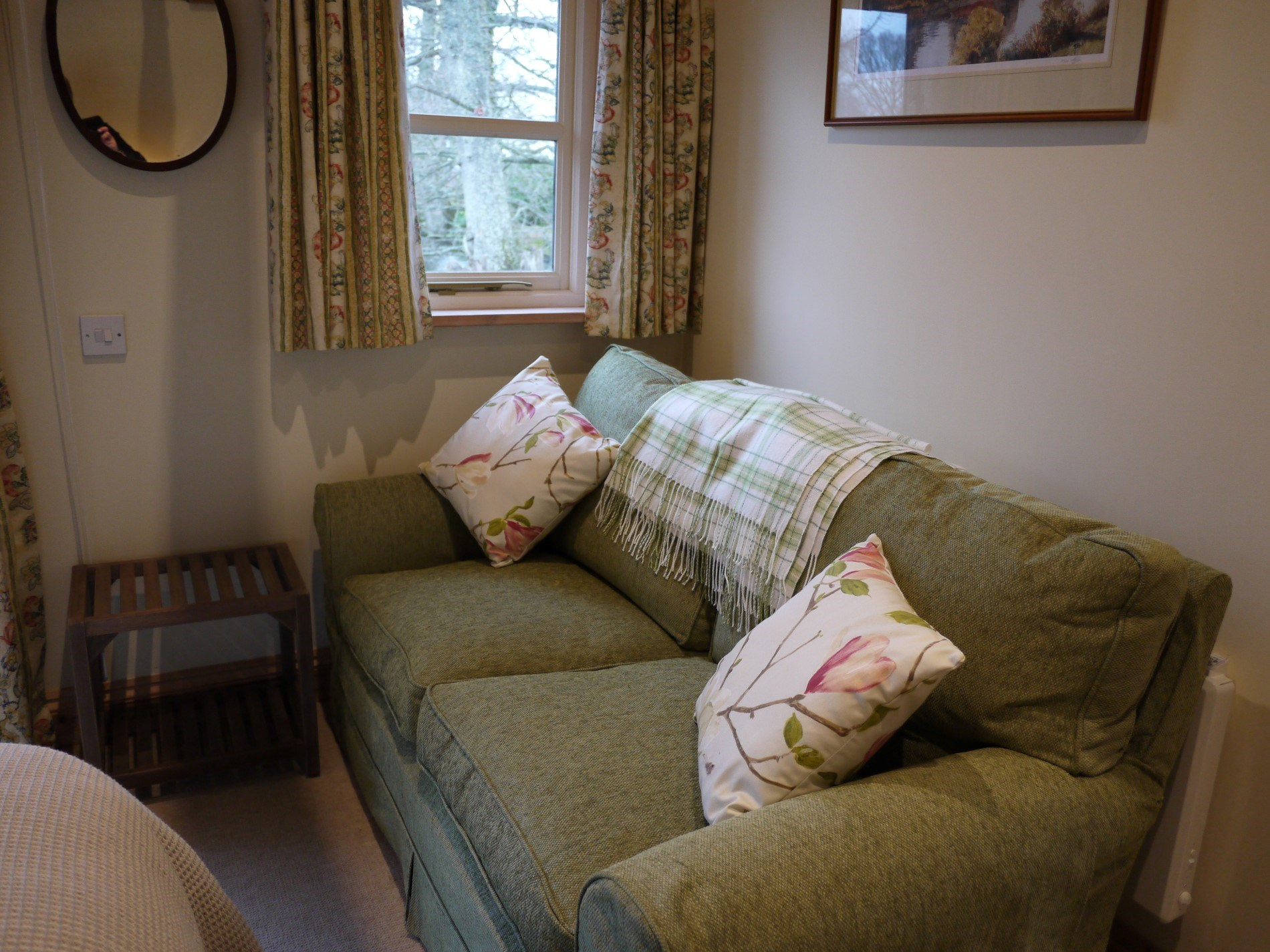 Comfy seating located in bedroom