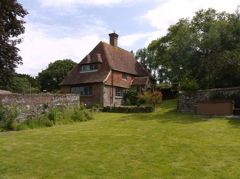 Surrounded by extensive gardens with far reaching views