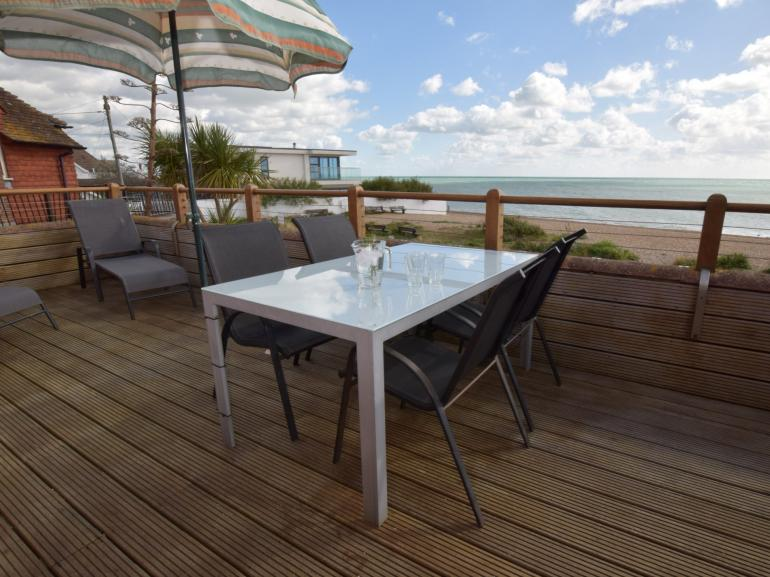 Eat al fresco with stunning views out to sea from this beachside property