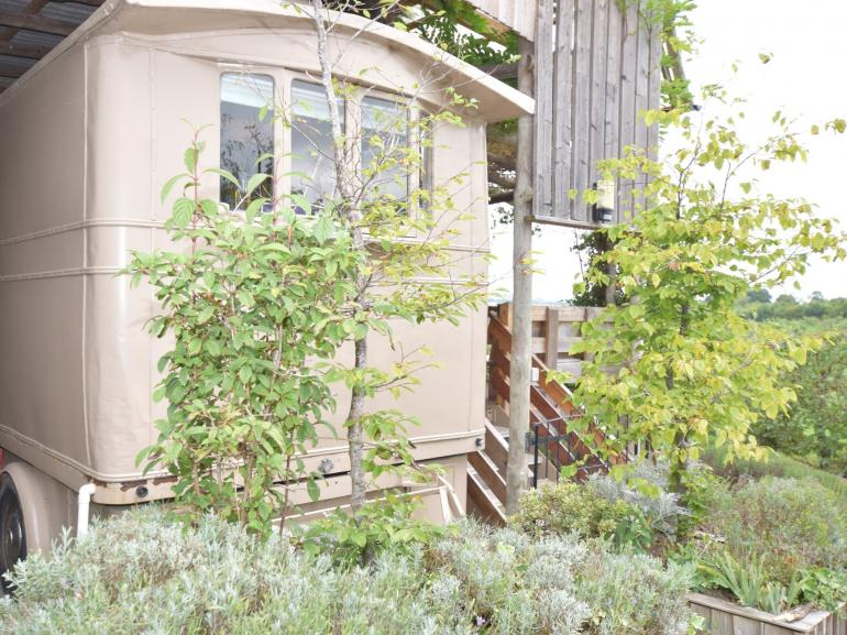 Lovingly restored former showman's carriage in idyllic location