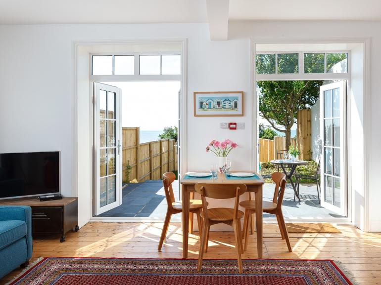 Enjoy the garden and sea views from this coastal retreat for two
