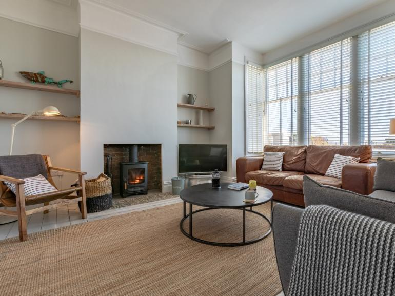 Lounge area with cosy wood burner