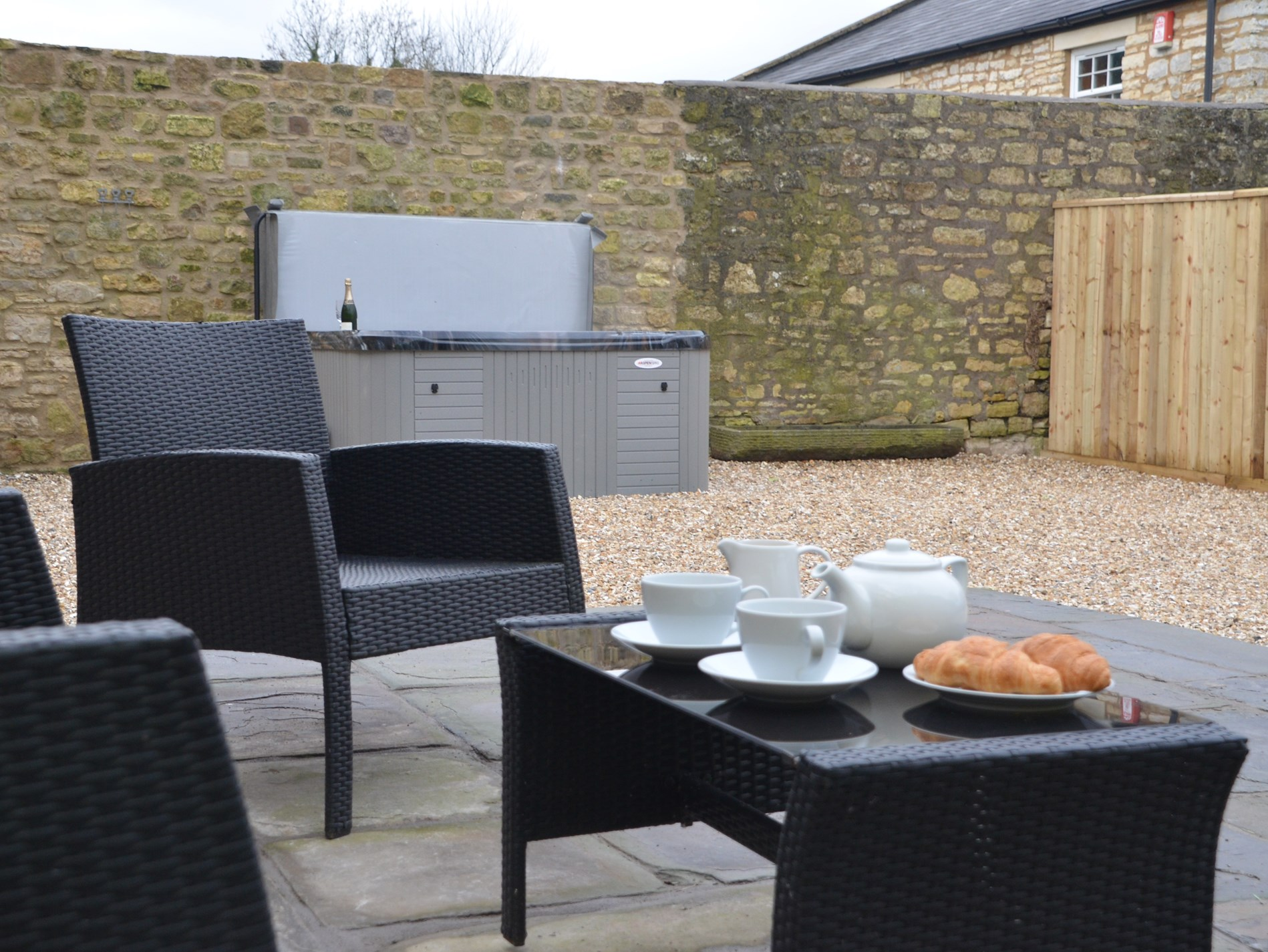 Outside seating area and hot tub