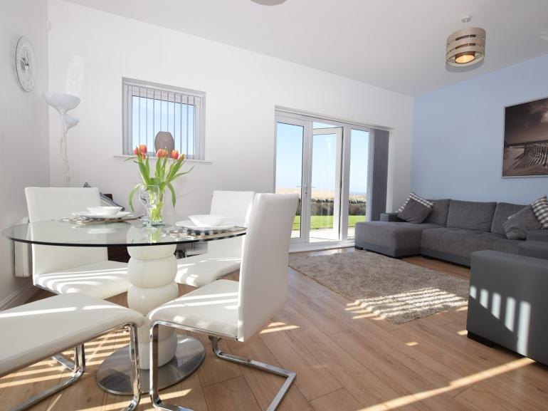 Spacious open-plan lounge with sea views