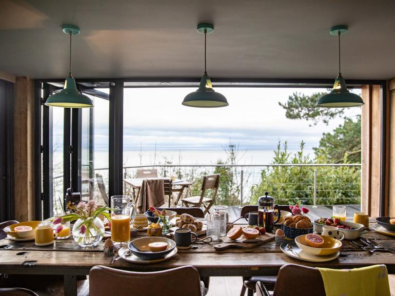 Dine indoors or out with panoramic sea views