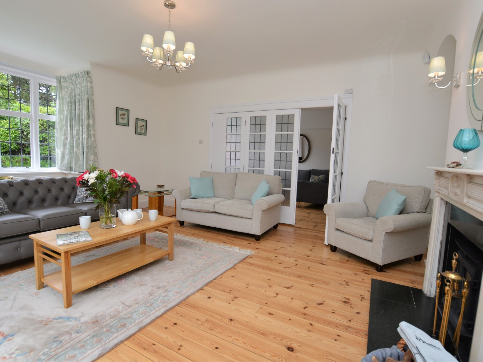 Spacious lounge with doors leading to the snug and hallway