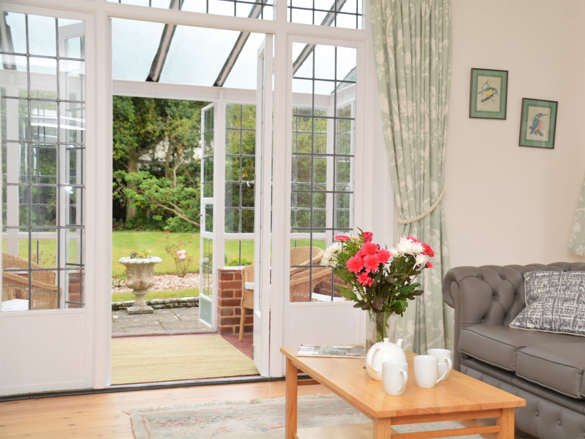 Light and airy lounge leading to the sun room and garden
