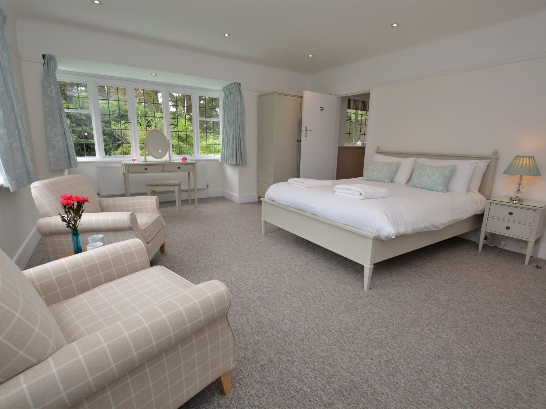 King-size bedroom with en-suite shower room