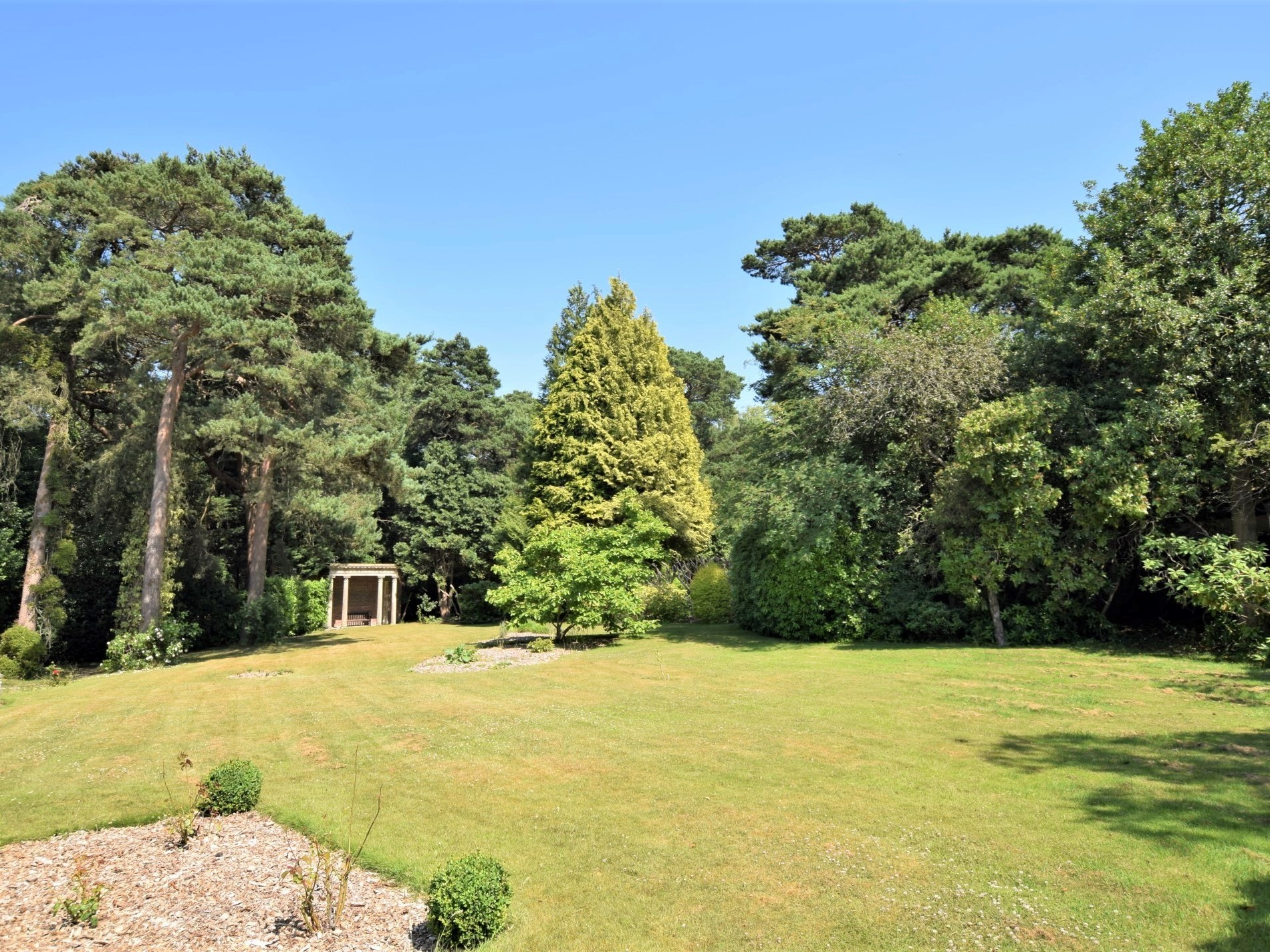 Relax in the enclosed gardens edged with woodland