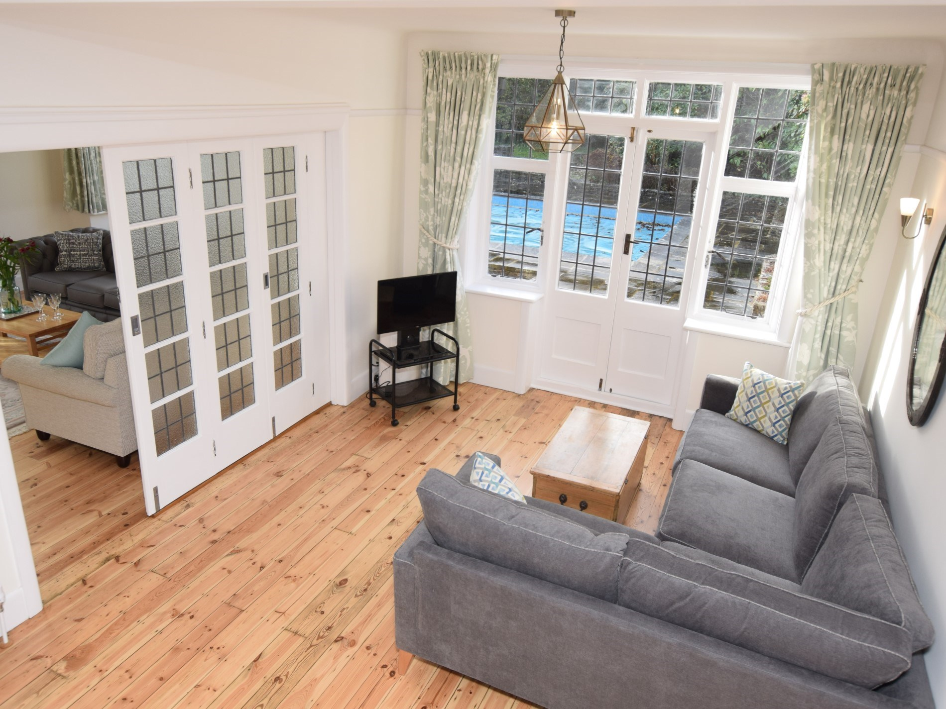 Snug with doors leading to the garden