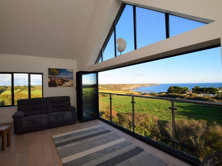 Pull open the bi-fold doors and relish the sea views