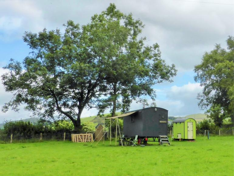 View towards the quirky shepherds hut with seperate shower room
