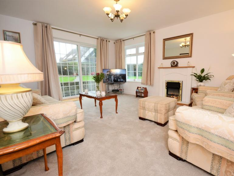 Lovely lounge with patio doors leading to the garden