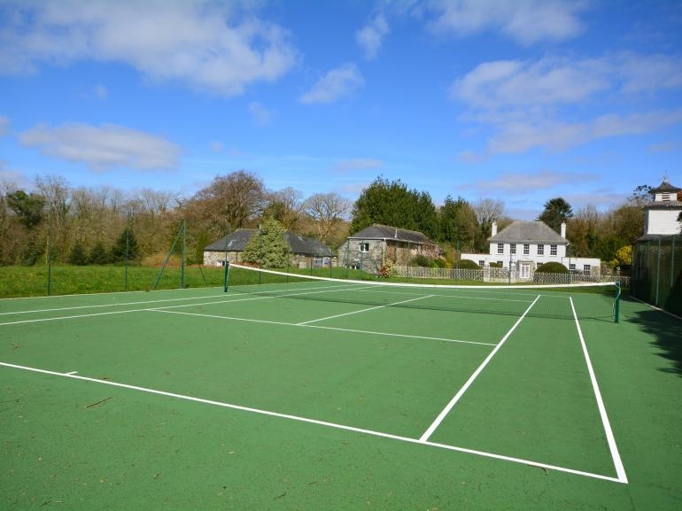 Tennis court on site with views towards the manor house