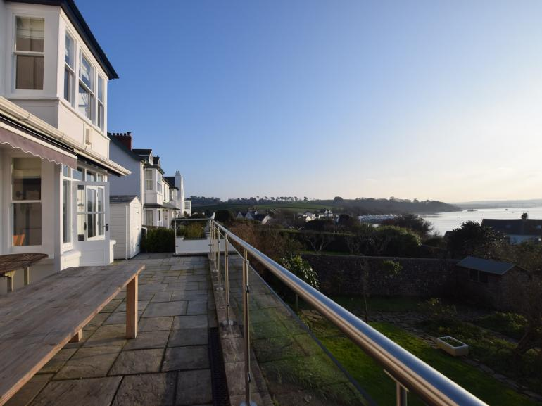 View from the terrace over the private garden and across the estuary