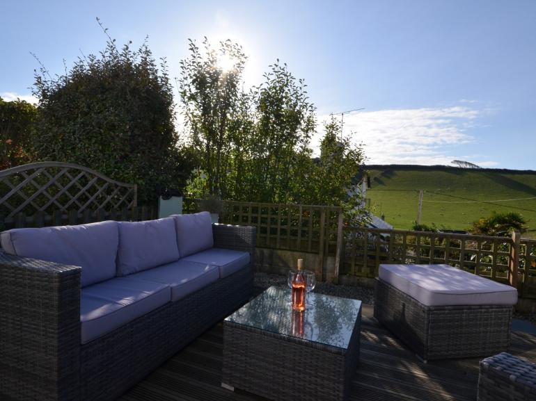 Relax in the enclosed garden with patio area, seating and BBQ