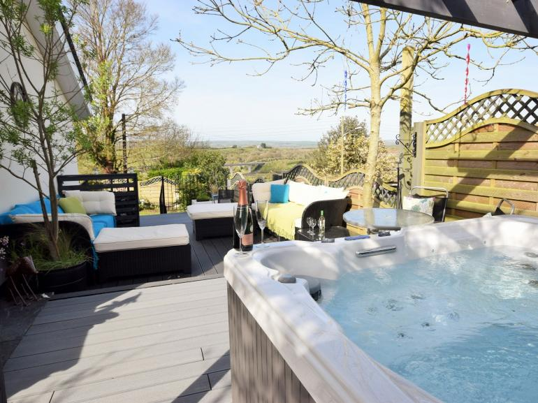 Enjoy the hot tub with fantastic views to the estuary