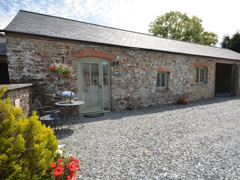 View towards the barn with outside seating area