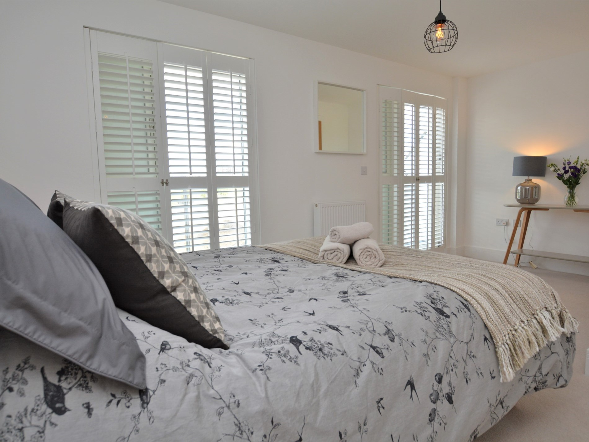 King-size bedroom with balcony and en-suite shower room