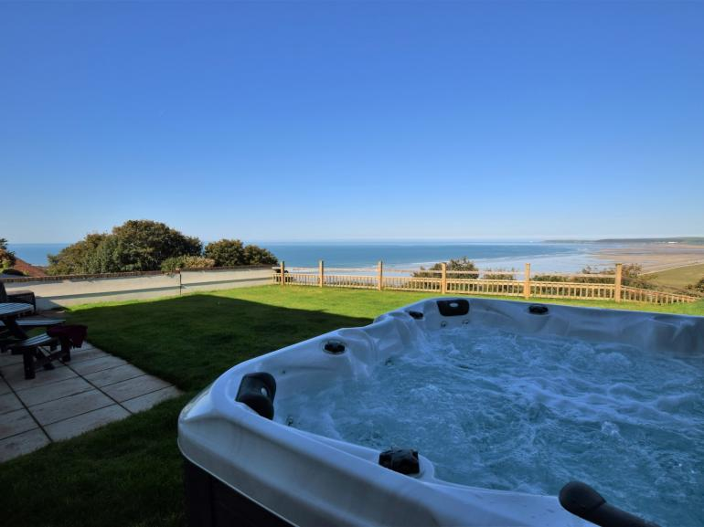 Enjoy stunning sea views from the hot tub