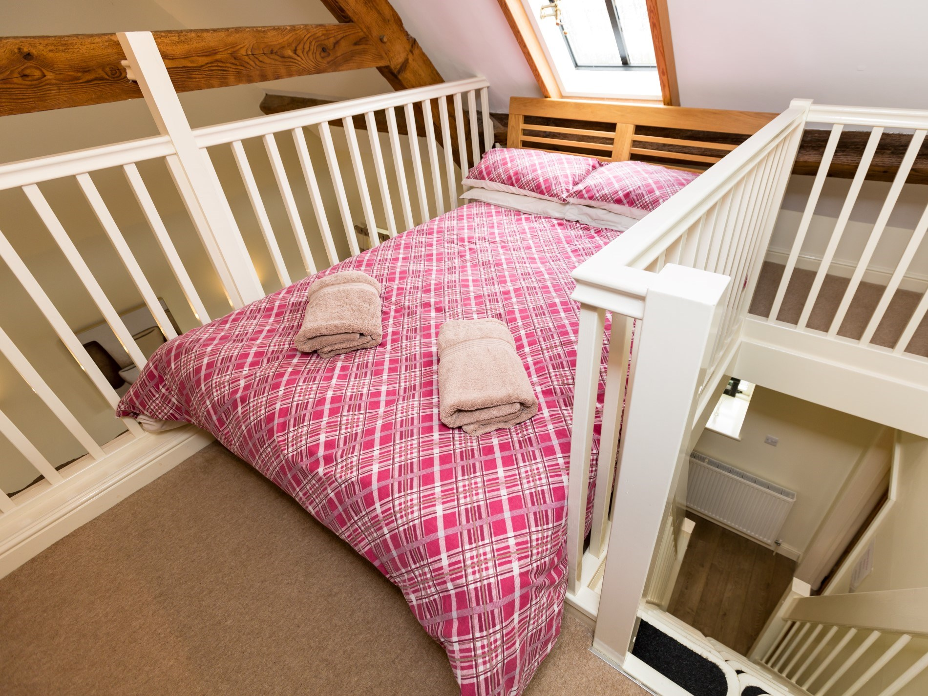 Double bed in mezzanine area