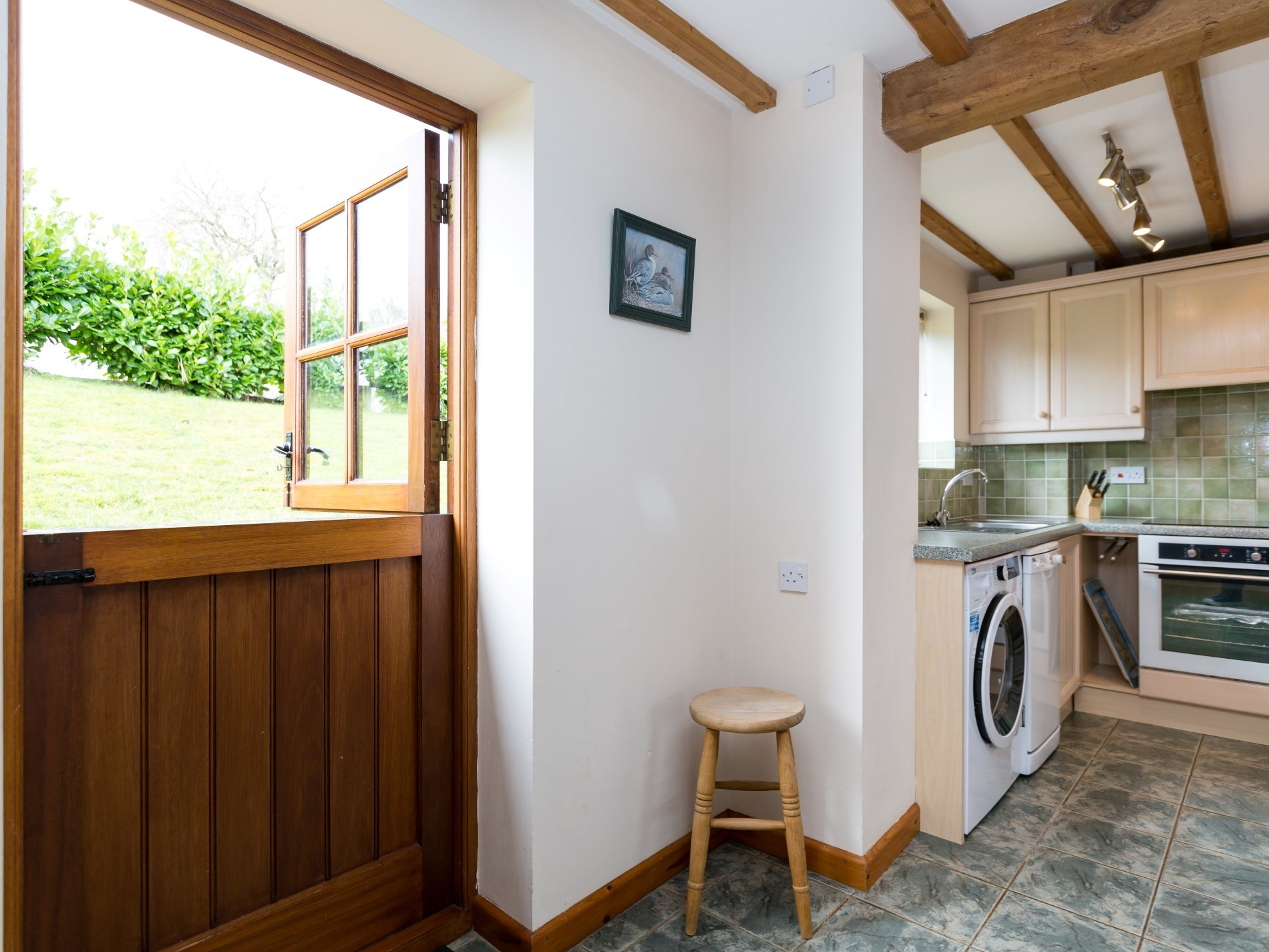 Kitchen area with stable door to outside