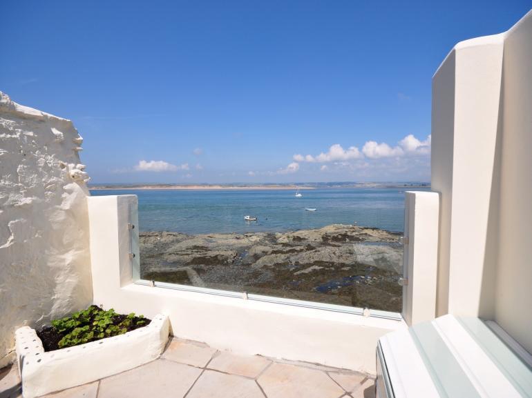 Enclosed patio area with sea views