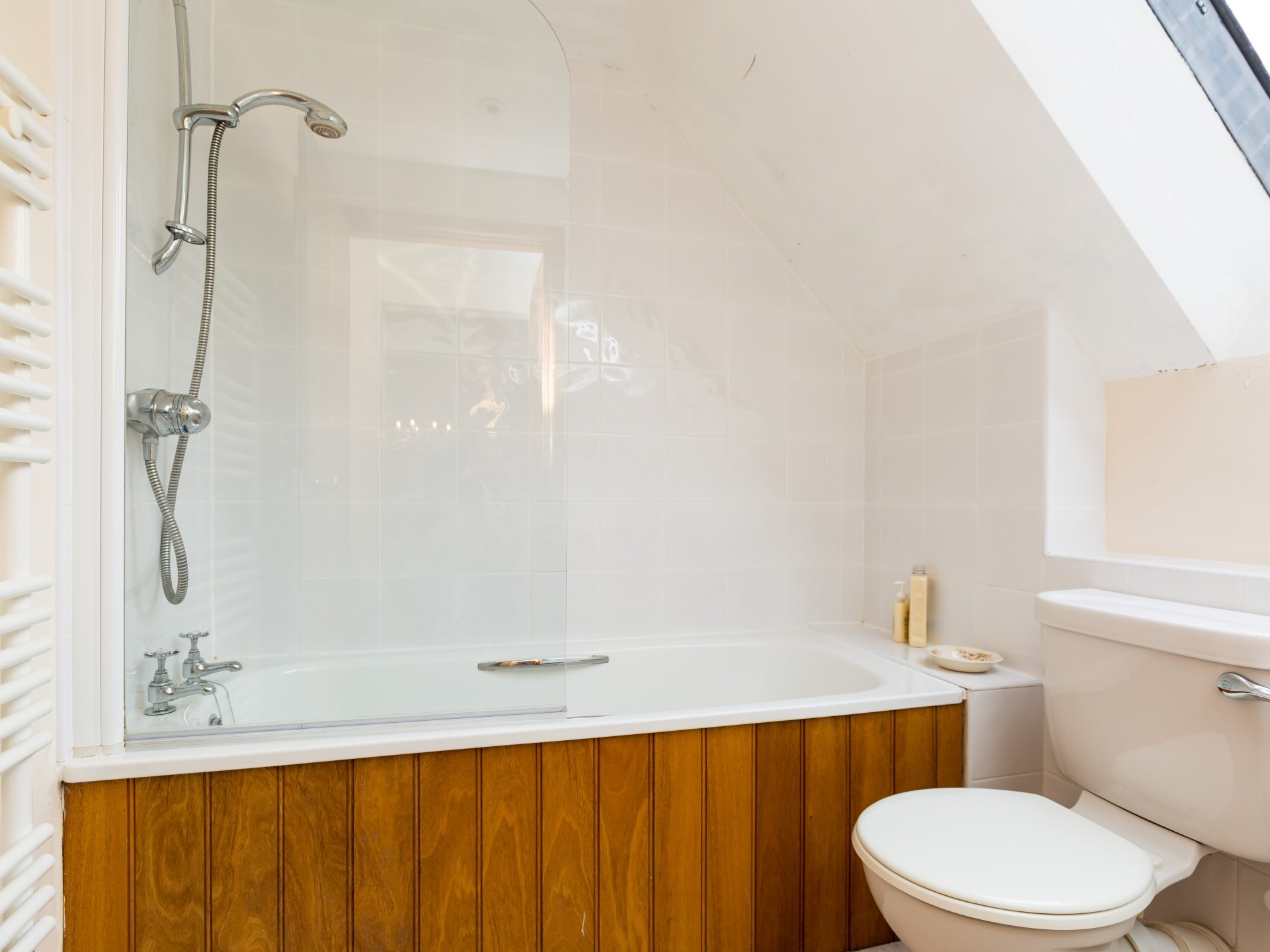 Bathroom with shower over bath