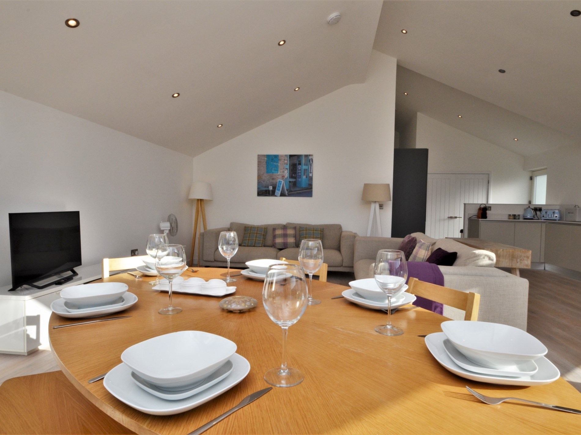 A light and spacopus lounge/dining/kitchen area